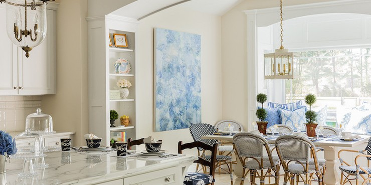 arched-doorway-with-built-ins-white-trestle-dining-table-navy-bistro-chairs