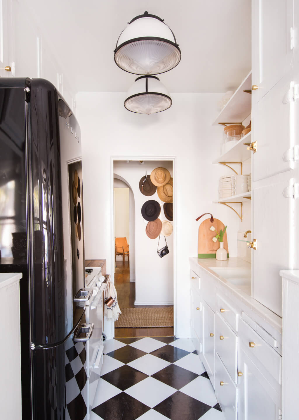 Brady-Tolbert_Emily-Henderson_Black-and-White-Kitchen_Vintage_Apartment-Refresh_Wood_Brass_Checkered-Floor_Copper-Pots_Eclectic_Glam_Modern_Traditional_22-1024x1436