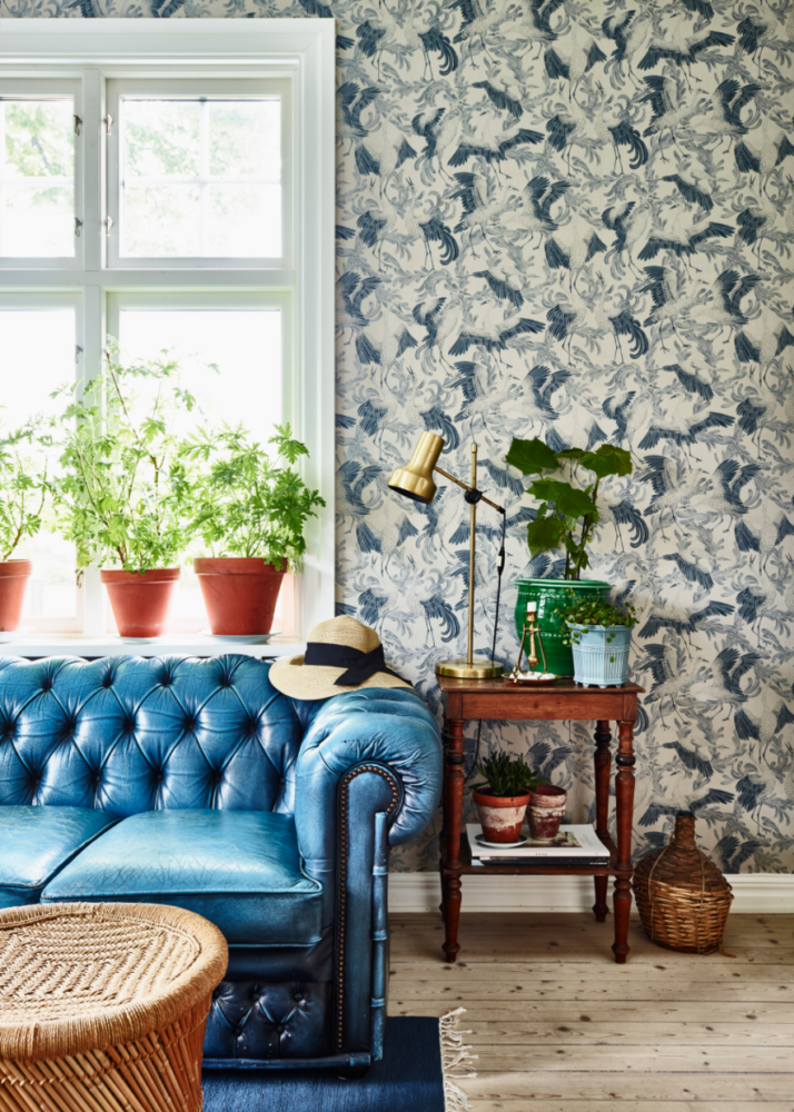 blue-and-white-wallpaper-with-a-blue-leather-sofa-swedish-house-tour-on-coco-kelley-714x1000
